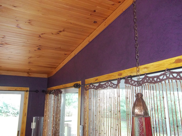 the trim is Faux, and walls have a drk. glaze